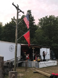 the American flag followed by the Marine Corps flag
